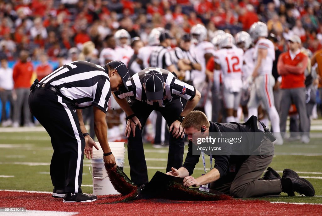 A tear in the field is evaluated as the Ohio State Buckeyes take on the Wisconsin Badgers during the Big Ten Championship game at Lucas Oil Stadium on December 2, 2017 in Indianapolis, Indiana. The Ohio State Buckeyes won 27-21.
