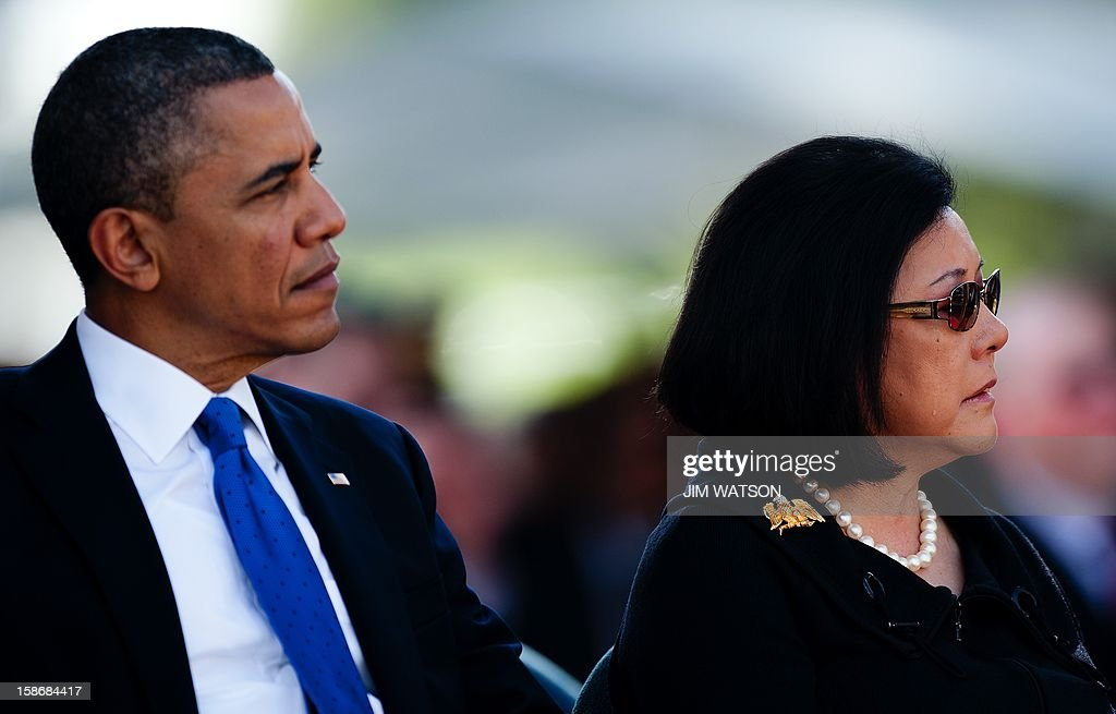 A tear runs down the cheak of widow Irene Hirano Inouye (R) as she sits with US President Barack Obama (L) during the memorial service for the late Senator Daniel Inouye at the National Memorial Cemetery of the Pacific in Honolulu, Hawaii, December 23, 2012. AFP Photo/Jim WATSON