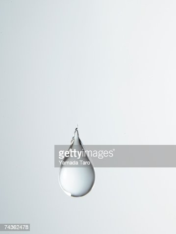 Tear shaped water drop suspended in air, close-up