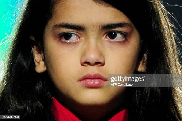 A tearful Blanket Jackson son of michael Jackson sheds a tear as he appears on stage during the 'Michael Forever' concert in memory of the late...