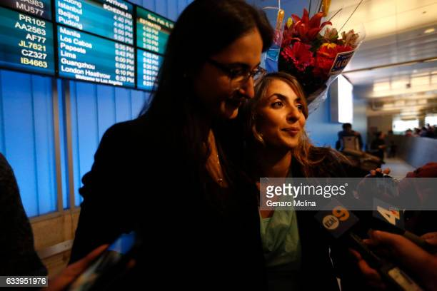 A tearful California student Sara Yarjani right is welcomed by her sister Sahar Muranovic at the Tom Bradley International Terminal at LAX on...