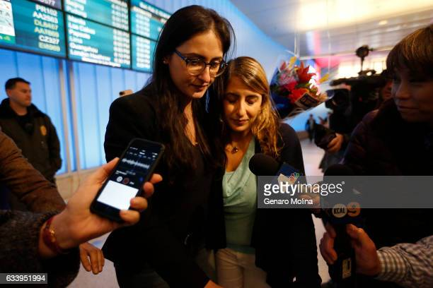 A tearful California student Sara Yarjani right is welcomed by her sister Sahar Muranovic after arriving at the Tom Bradley International Terminal at...
