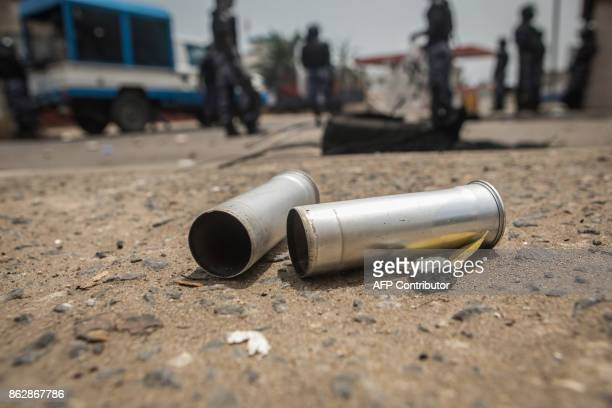 Teargas canisters are seen during clashes between protesters and security forces as part of an antigovernment protest in Lome on October 18 2017...