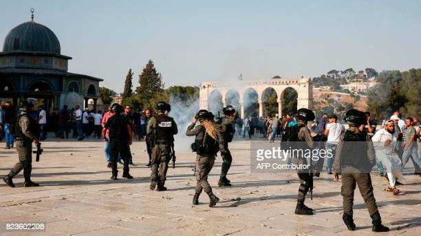 Teargas fumes are seen in the Haram alSharif compound as Israeli security forces disperse Palestinians who entered the complex in the old city of...
