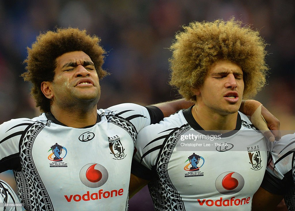Tears flow from the eyes of Vitale Junior Roqica and Eloni Vunakece of Fiji as they sign their national anthem during the Rugby League World Cup Semi...
