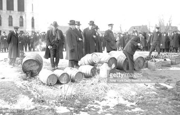 Tears mix with beer in as prohibition agents destroy the unlawful liquor much of which was seized in a Hoboken raid
