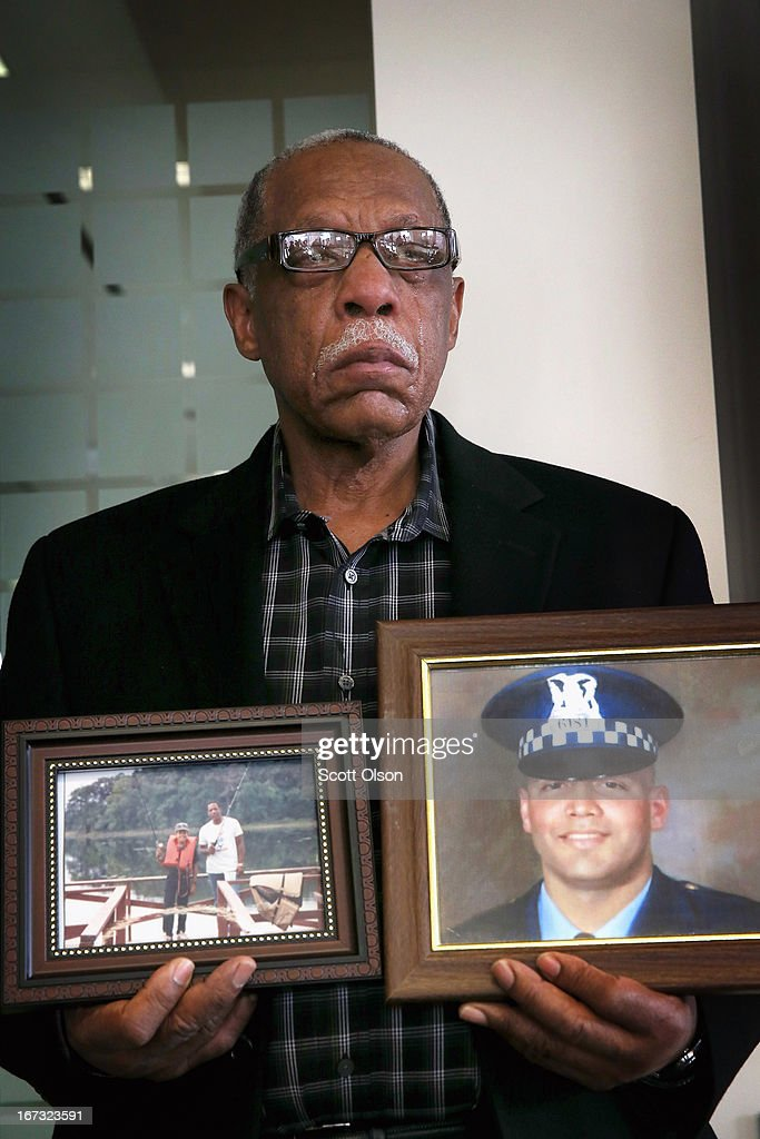 Tears roll down the face of retired Chicago police officer Thomas Wortham III as he holds pictures of his son while listening to his wife speak during a press conference where it was announced that a lawsuit has been filed by the Brady Center to Prevent Gun Violence on behalf of the Wortham family against Ed's Pawn Shop and Salvage Yard in Byhalia, Mississippi on April 24, 2013 in Chicago, Illinois. The suit claims that Wortham's son, Chicago Police officer and Iraq War veteran Thomas Wortham IV, was killed by a gun wrongfully sold to a straw purchaser at the pawn shop. Wortham IV was killed outside his parents' home on May 19, 2010 when 4 reported gang members tried to rob him of his motorcycle.