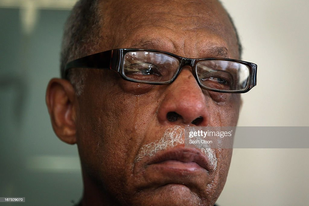 Tears roll down the face of retired Chicago police officer Thomas Wortham III as he listens to his wife speak during a press conference where it was announced that a lawsuit has been filed by the Brady Center to Prevent Gun Violence on behalf of the Wortham family against Ed's Pawn Shop and Salvage Yard in Byhalia, Mississippi on April 24, 2013 in Chicago, Illinois. The suit claims that Wortham's son, Chicago Police officer and Iraq War veteran Thomas Wortham IV, was killed by a gun wrongfully sold to a straw purchaser at the pawn shop. Wortham IV was killed outside his parents' home on May 19, 2010 when 4 reported gang members tried to rob him of his motorcycle.
