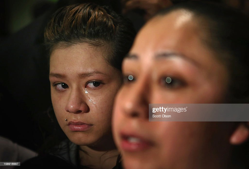Tears run down the face of Desiree Velasquez (L) as she listens to her mother Diana Aguilar talk about the murder of her six-year-old sister Aliyah during a press conference at St. Sabina Church January 3, 2013 in Chicago, Illinois. Aliyah was shot and killed while sitting on the steps of the family home on March 17, 2012. The press conference was called to make a plea for stronger gun regulations including a ban on assault weapons. In 2012 Chicago reported 506 murders. In the first 3 days of 2013 Chicago has had 5 murders.
