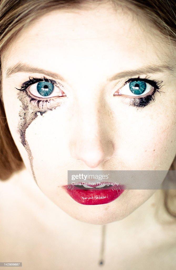 Tears with mascara : Stock Photo
