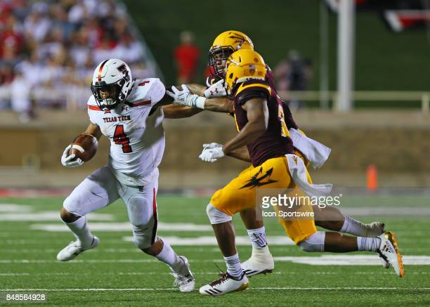 Teas Tech running back Justin Stockton fends off the tackle during the Texas Tech Raider's 5245 victory over the Arizona State Sun Devils on...