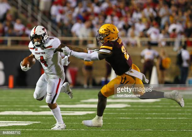 Teas Tech running back Justin Stockton fends off the tackle of arizona state linebacker Christian Sam during the Texas Tech Raider's 5245 victory...