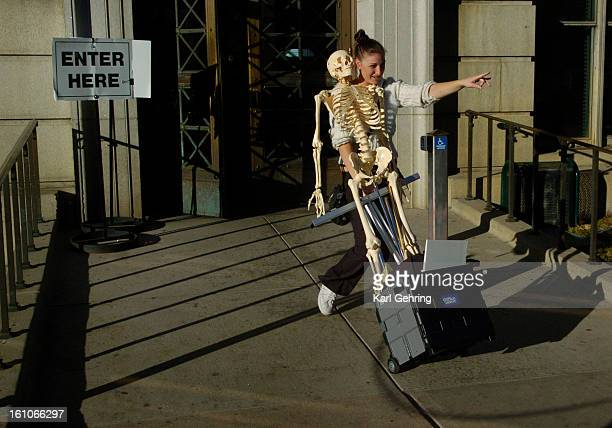 FEATURE Teasha Horner a file clerk at the the Waltz Law Firm carted a skeleton out of the Denver City and County Building Wednesday afternoon after...