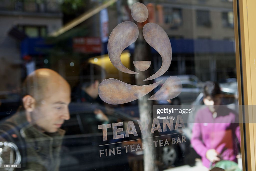 Teavana signage is displayed in the window of a tea bar in New York, U.S., on Thursday, Oct. 24, 2013. Starbucks Corp., the world's largest coffee-shop chain, is opening its first Teavana tea bar in New York as the company pushes beyond its signature drink. Photographer: Mati Milstein/Bloomberg via Getty Images
