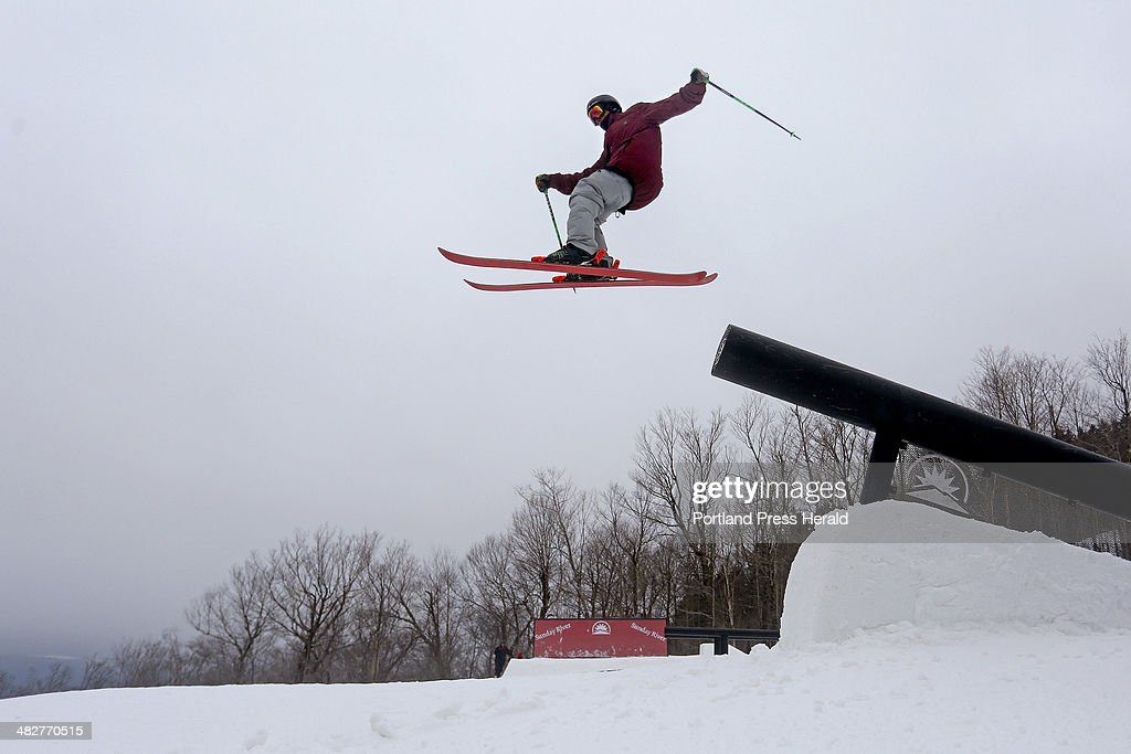 Tec Calcagni, of Park City, Utah, flies off a rail while competing in the 6th annual Dumont Cup at Sunday River Ski Resort in Newry, Friday March 28, 2014.