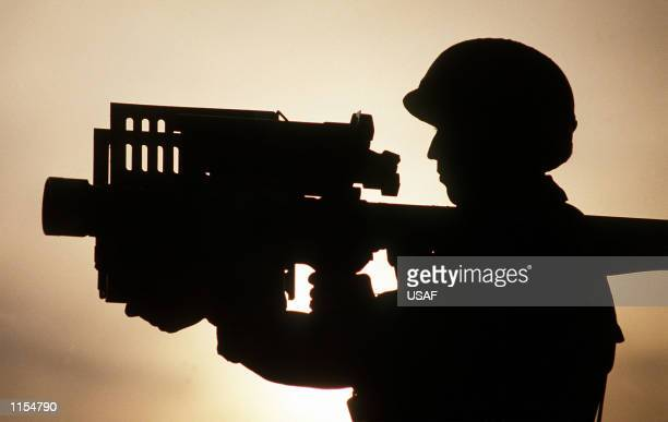 Tech Sgt Mike Garcia of the 8th Security Police Squadron is silhouetted against the sky as he holds a Stinger antiaircraft guided missile during the...