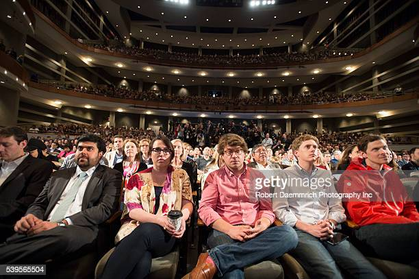 Techies listen as US President Barack Obama speaks about the digital divide with Texas Tribune editor Evan Smith during a keynote speech at South by...