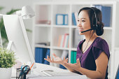 Vietnamese technic support operator in a headset
