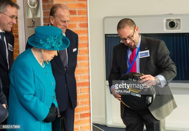 Technical Director Dr Ian Levy shows Queen Elizabeth II and the Prince Philip Duke of Edinburgh a robot vacuum cleaner which could be vulnerable to...