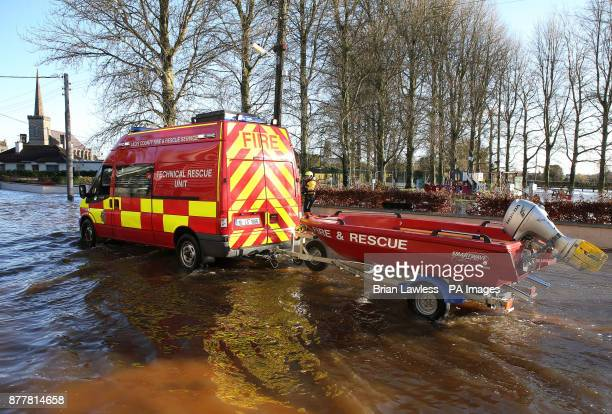 A technical rescue unit of the fire service drives through flood water in Mountmellick Co Laois after three rivers burst their banks and flooded...