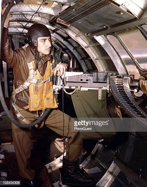 Technical Sergeant Mexico Barraza gunner and radio operator in position at the waist gun of a B17 Flying Fortress England mid1940s