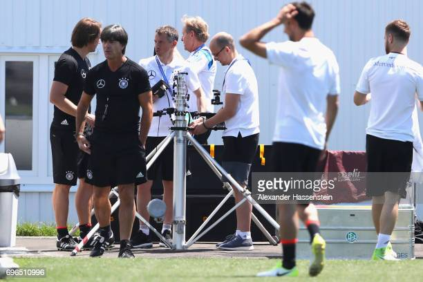 Technical staff check equipment at the training ground during a training session of team Germany at Park Arena training ground on June 16 2017 in...