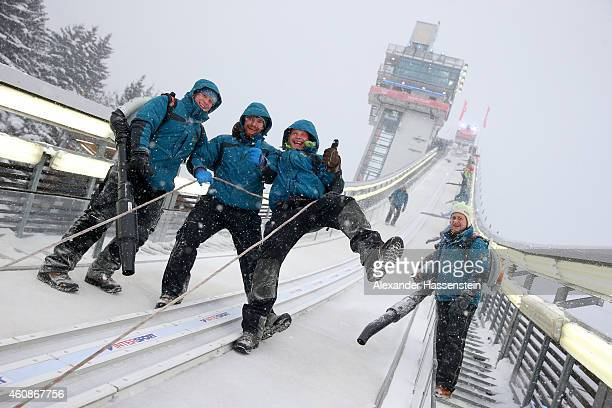 Technicans joke as thei prepare the jumping hill during a break in the heavy snow and windy conditions on day 2 of the Four Hills Tournament Ski...