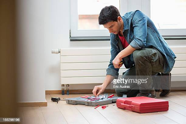 Technician arranging his toolbox
