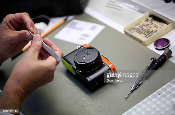 A technician assembles a Leica X2 digital camera designed by Paul Smith at the Leica Camera AG headquarters in Solms Germany on Wednesday Oct 31 2012...