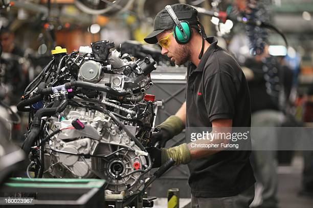 A technician assembles a Nissan car on the production line at Nissan's Sunderland plant on January 24 2013 in Sunderland England The Japanese...