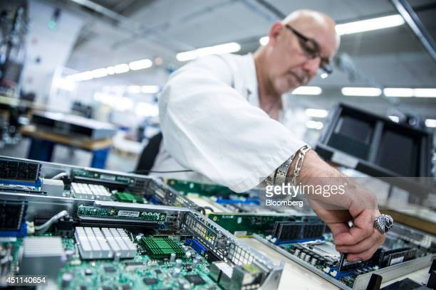 A technician assembles motherboards for Bullx R computer systems at the Bull SA headquarters in Angers France on Monday June 23 2014 Thierry Breton...