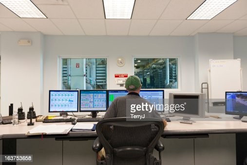 Technician at the Computers in a Control Room