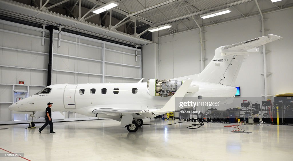 Technician Brad Johnson works on an Embraer SA Phenom 300 Light Business Jet before it is painted at the company's executive jet manufacturing facility in Melbourne, Florida, U.S., on Monday, July 15, 2013. Embraer SA, the world's largest manufacturer of commercial jets up to 120 seats, delivered 22 jets to the commercial aviation market and 29 to the executive aviation market, for a total of 51 aircraft in the second quarter of 2013, according to a company press release. Photographer: Mark Elias/Bloomberg via Getty Images