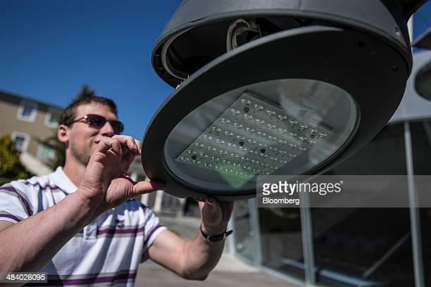 A technician carries out maintenance on a Philips Mini CitySoul light emitting diode street light at Royal Philips NV's outdoor lighting application...