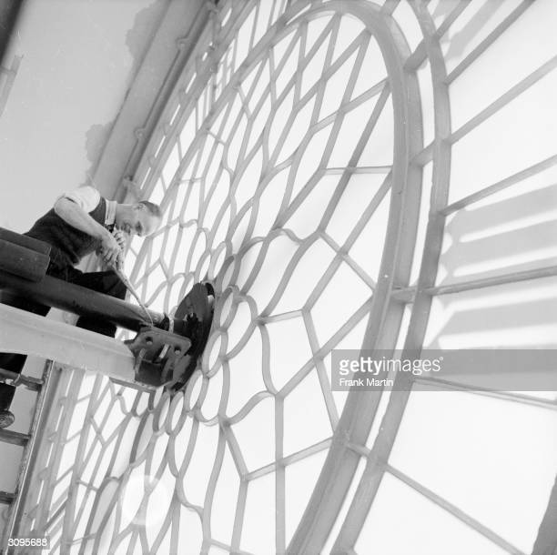 Technician Charles King carries out maintenance work behind the great clock face of Big Ben in the Palace of Westminster London