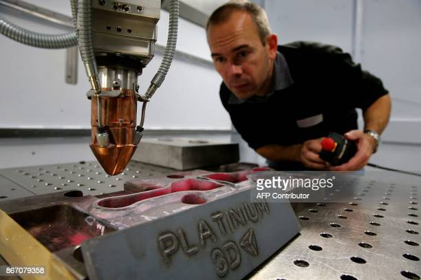 A technician checks a metal 3D printer at the Platinium 3D scientific and technology platform in CharlevilleMezieres northeastern France on October...