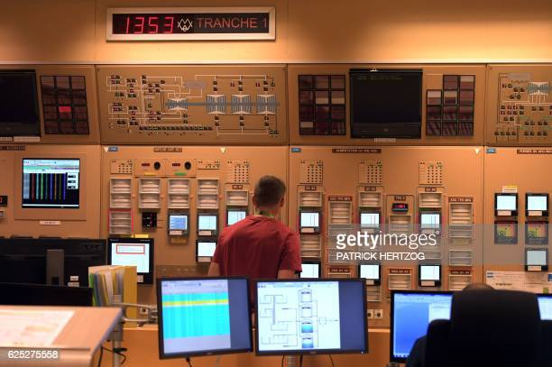A technician checks screens on November 18 2016 inside the control room of a reactor building at the nuclear power plant in Cattenom eastern France...
