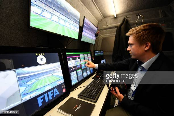 TOPSHOT A technician checks the video arbitration system that will be used during the friendly football match France vs Spain on March 28 2017 at the...
