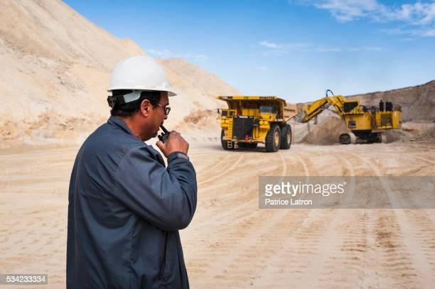 Technician Control Dump Truck in Open Phosphate Mine