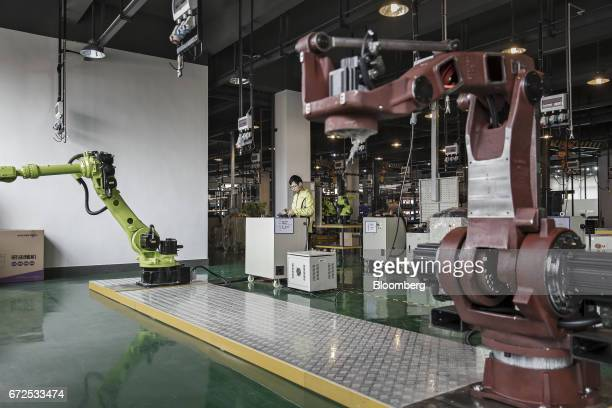 A technician controls an industrial robot on the testing line of a factory operated by EDeodar Robot Equipment Co a whollyowned subsidiary of Ningbo...