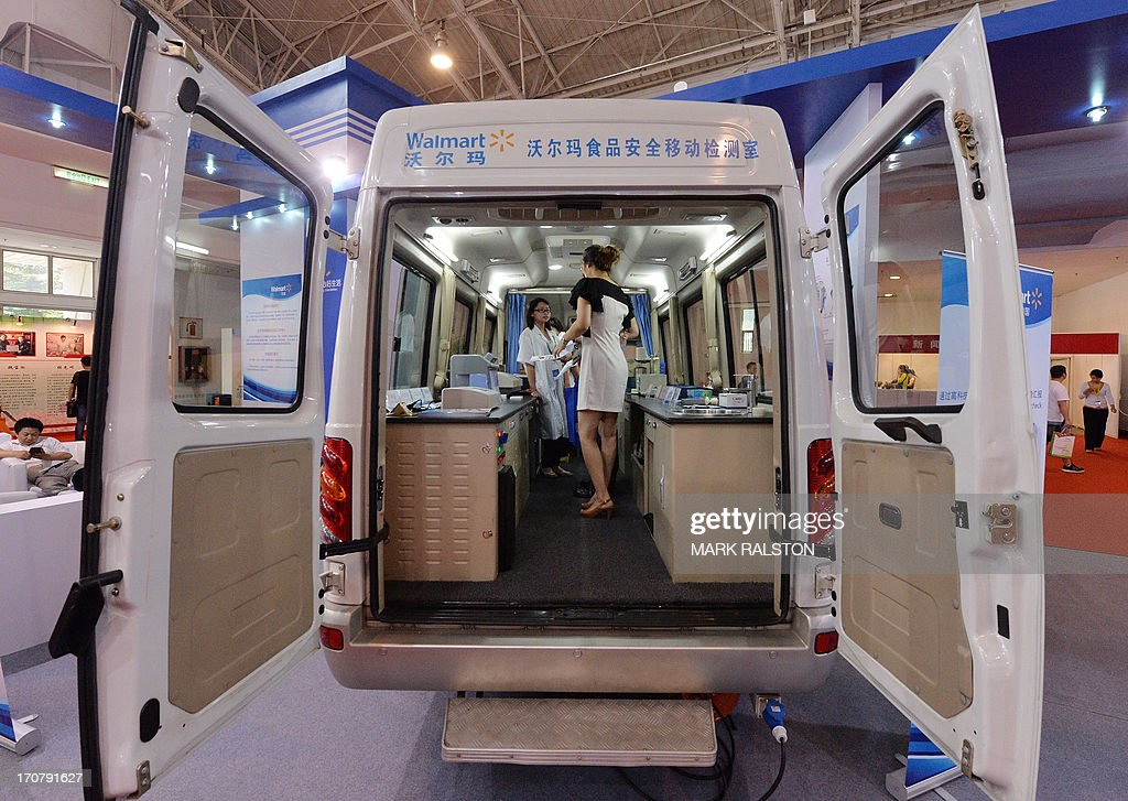 A technician demonstrates procedures in a mobile food testing vehicle that will be used by Walmart to test food from their suppliers at the China International Food Safety Technology & Innovations Expo in Beijing on June 18, 2013. China has recently been hit by a string of food scandals including one selling rat and fox meat as beef and mutton and others selling recycled cooking oil to restaurants and using dangerous chemicals in baby milk powder. AFP PHOTO/ Mark RALSTON