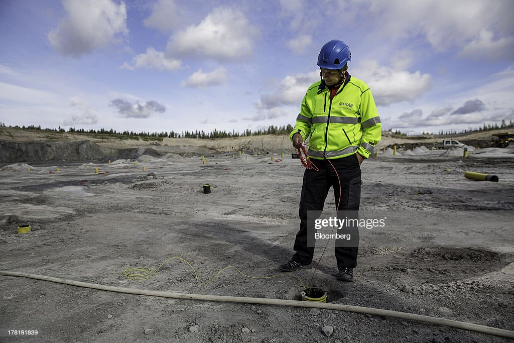 A technician examines wiring as he prepares explosives before blasting a section of ground at the open cast iron ore mine run by LKAB, Sweden's state-owned mining company, in Svappavaara near Kiruna, Sweden, on Thursday, Aug. 22, 2013. Swedes living in the Arctic town of Kiruna are packing up their belongings before their homes are bulldozed to make way for iron ore mining driven by Chinese demand. Photographer: Casper Hedberg/Bloomberg via Getty Images