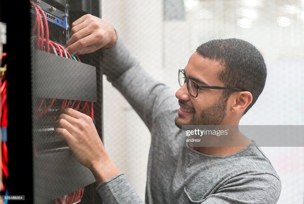IT technician fixing a server at the office : Stock Photo