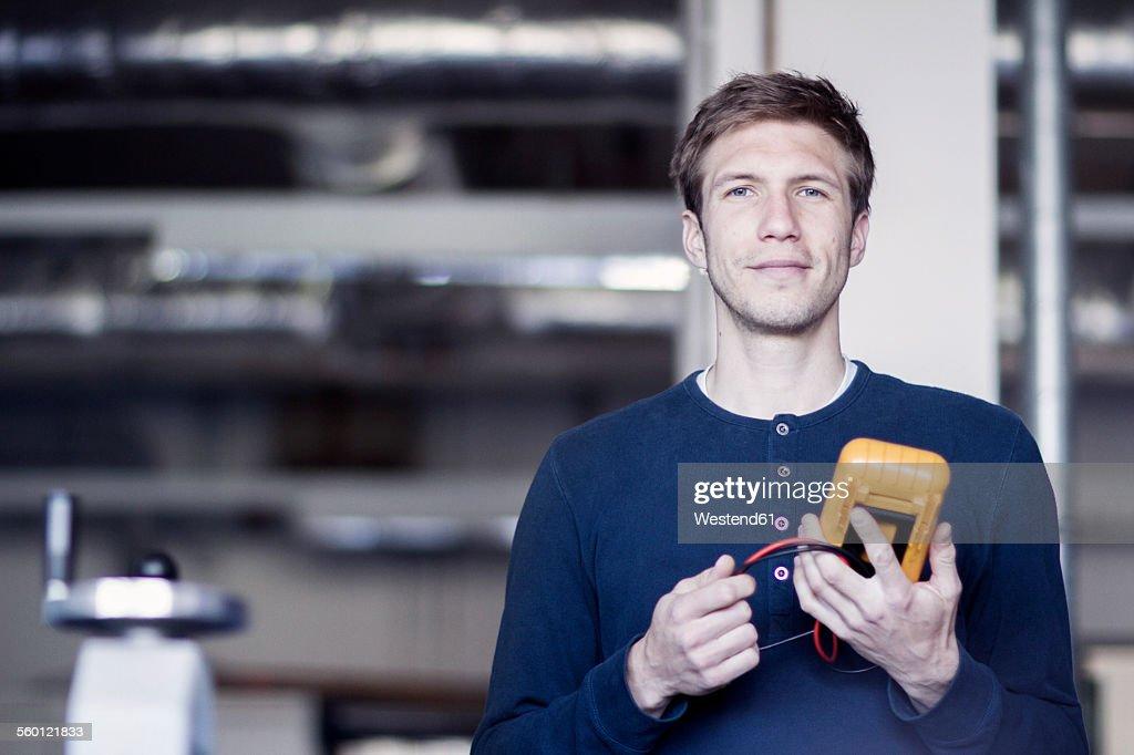 Technician holding measuring device