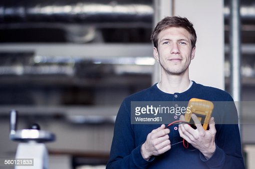 Technician holding measuring device