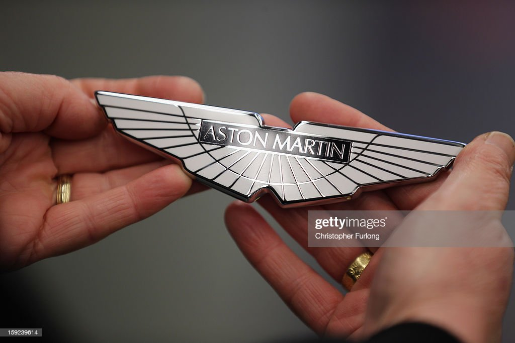 A technician holds a set of 'Wings' before fixing them to an Aston Martin motor car at the company headquarters and production plant on January 10, 2013 in Gaydon, England. The iconic British brand is celebrating its 100th anniversary. Lionel Martin and Robert Bamford created Bamford & Martin on January 15 1913, which later became Aston Martin in honour of Bamford's wins at the Aston Clinton Hillclimb in Buckinghamshire.