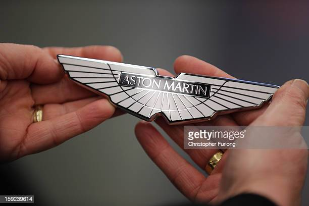 A technician holds a set of 'Wings' before fixing them to an Aston Martin motor car at the company headquarters and production plant on January 10...