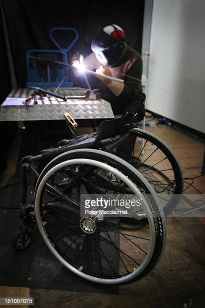 Technician Hughes Myner welds a broken back rest on a wheelchair belonging to a Canadian athlete at the Ottobock repair workshop at the London 2012...