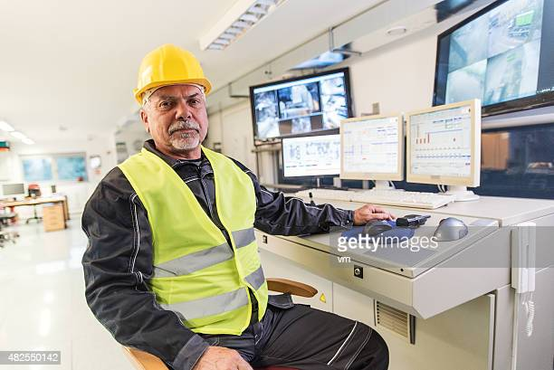Technician in control room looking at camera