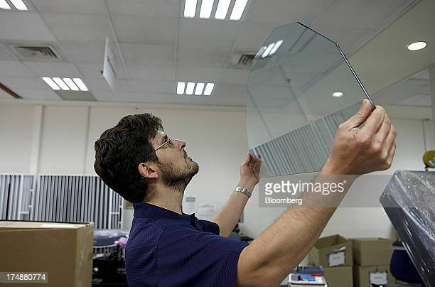 A technician inspects a glass screen during the assembly of a 3D digital printing machine at the Stratasys Ltd factory in Rehovot Israel on Sunday...